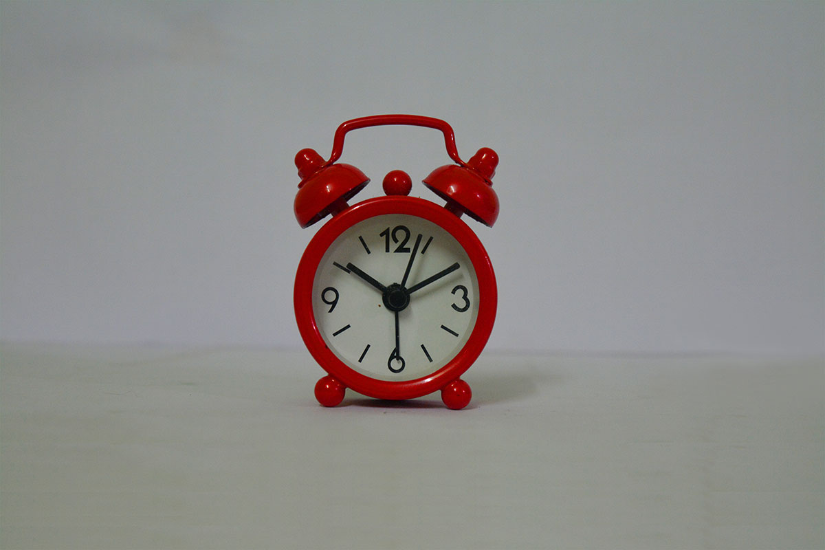 Red Old Style Alarm On White Paper Vintage Style Alarm Clock Over